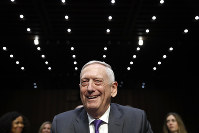 Defense Secretary Jim Mattis smiles as he arrives to testify on the Department of Defense budget posture, during a Senate Armed Services Committee hearing on Capitol Hill in Washington, on April 26, 2018. (AP Photo/Jacquelyn Martin)