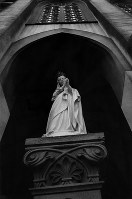 A figure of the Virgin Mary is seen at the entrance of Oura Church in Nagasaki in January 1968. (Mainichi)