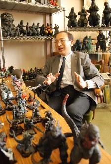 Professor Hiroshi Ito talks about Godzilla and the Constitution at his office. (Mainichi)