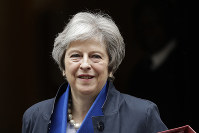 British Prime Minister Theresa May leaves 10 Downing Street in London, to attend Prime Minister's Questions at the Houses of Parliament, Wednesday, May 2, 2018. (AP Photo/Matt Dunham)