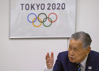 In this file photo dated April 10, 2018, Tokyo 2020 Olympics President Yoshiro Mori speaks during an executive board meeting in Tokyo. (AP Photo/Shizuo Kambayashi)