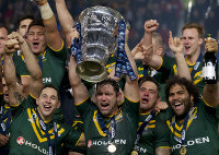 In this Nov. 30, 2013 file photo, Australia's captain Cameron Smith, bottom center, celebrates with teammates after their 34-2 win over New Zealand in their World Cup Final International Rugby League match at Old Trafford Stadium in Manchester, England. (AP Photo/Jon Super)