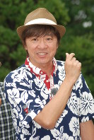 In this file photo dated July 3, 2012, singer Hideki Saijo poses for a picture as part of a promotion for his TV program focusing on the garden farming of vegetables. Saijo had recovered from a second stroke he suffered in late 2011. (Mainichi)