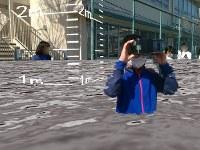 「浸水1メートル」ではどこまで漬かる? 箱に装着したスマートフォンのAR映像を見ながら浸水被害を疑似体験する子どもたち=東京都三鷹市立第七小で、板宮朋基教授提供