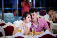 A couple sit in a restaurant on a boat on the Dae Dong Gang river in North Korea in August 2017. (Photo courtesy of Ari Hatsuzawa)