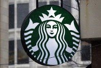 This March 14, 2017, file photo show the Starbucks logo on a shop in downtown Pittsburgh. (AP Photo/Gene J. Puskar, File)