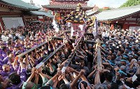 Participants carry a portable shrine belonging to Asakusa Jinja shrine for one of Tokyo's three great festivals, the
