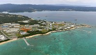 The sea off the Henoko district of the Okinawa Prefecture city of Nago, where U.S. military base relocation work is underway, is pictured in this photo taken from a Mainichi Shimbun aircraft on Jan. 27, 2018. (Mainichi)