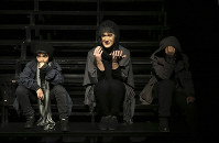 In this Feb. 25, 2018 photo, Iranian actor Behnam Sharafi, center, plays his role as a transgender woman in the play