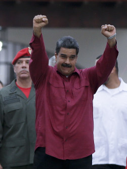 Venezuela's President Nicolas Maduro raises his fists after voting in presidential elections in Caracas, Venezuela, on May 20, 2018. (AP Photo/Ricardo Mazalan)