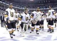 Vegas Golden Knights' James Neal (18), Deryk Engelland (5), goaltender Marc-Andre Fleury (29) and the rest of the team celebrate after defeating the Winnipeg Jets during NHL Western Conference Finals, game 5, in Winnipeg, on May 20, 2018. (Trevor Hagan/The Canadian Press via AP)