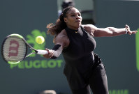 In this March 21, 2018 file photo, Serena Williams returns to Naomi Osaka, of Japan, during the Miami Open tennis tournament, in Key Biscayne, Florida. (AP Photo/Lynne Sladky, File)