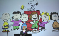 Sony Corp. President Kenichiro Yoshida speaks as characters from Peanuts are shown at a news conference at the company's headquarters on May 22, 2018, in Tokyo. (AP Photo/Eugene Hoshiko)