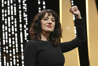 Actress Asia Argento gestures on stage during the closing ceremony of the 71st international film festival, Cannes, southern France, on May 19, 2018. (Vianney Le Caer)