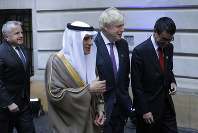 British Foreign Secretary Boris Johnson, center, talks to Japan's Foreign Minister Taro Kono, right, and Saudi Arabia's Minister of Foreign Affairs Adel al-Jubeir after posing for a group picture during the G20 foreign ministers meeting at San Martin Palace in Buenos Aires, Argentina, on May 21, 2018. (AP Photo/Natacha Pisarenko)