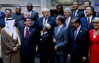 Foreign ministers and representatives of G20 member countries pose for a group picture during the G20 foreign ministers meeting at San Martin Palace in Buenos Aires, Argentina, on May 21, 2018. (AP Photo/Natacha Pisarenko)