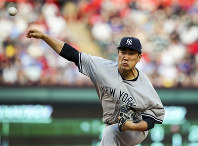 New York Yankees starting pitcher Masahiro Tanaka (19) delivers a pitch against the Texas Rangers in the first inning of a baseball game on May 21, 2018, in Arlington, Texas. (AP Photo/Richard W. Rodriguez)