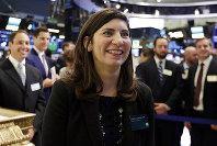 Stacey Cunningham, the current New York Stock Exchange COO, who will become the exchange's 67th president, visits the floor of the NYSE, Tuesday, May 22, 2018. Cunningham will become the first female leader in the history of the 226-year-old exchange. (AP Photo/Richard Drew)