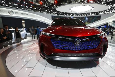 In this April 26, 2018, file photo, visitors look at a Buick Enspire concept car on display at the Auto China show in Beijing. (AP Photo/Andy Wong)