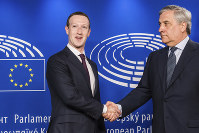European Parliament President Antonio Tajani, right, welcomes Facebook CEO Mark Zuckerberg upon his arrival at the EU Parliament in Brussels on May 22, 2018. (AP Photo/Geert Vanden Wijngaert)