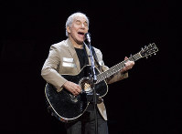 In this May 16, 2018 file photo, Paul Simon kicks off his Homeward Bound: The Farewell Tour in Vancouver, British Columbia. (Jimmy Jeong/The Canadian Press via AP)