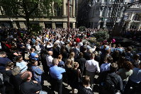 Members of the public observe a minute's silence as they gather in St Ann's Square to mark one year since the terror attack on Manchester Arena, on May 22, 2018. (Aaron Chown/PA via AP)
