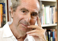 In this Sept. 8, 2008 file photo, author Philip Roth poses for a photo in the offices of his publisher, Houghton Mifflin, in New York. (AP Photo/Richard Drew)