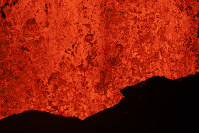 Lava erupts from a fissure in Kapoho, Hawaii on May 21, 2018. (AP Photo/Jae C. Hong)
