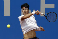 In this May 5, 2018, file photo, Chung Hyeon of South Korea returns the ball to Alexander Zverev of Germany during the semifinal match at the ATP tennis tournament in Munich, Germany. (AP Photo/Matthias Schrader)