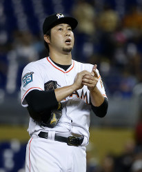 In this May 17, 2018 photo, Miami Marlins' Junichi Tazawa, of Japan, prepares to pitch during the fourth inning of a baseball game against the Los Angeles Dodgers, in Miami. (AP Photo/Wilfredo Lee)