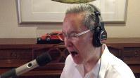 Songwriter Hiroaki Serizawa sings in the studio. (Photo courtesy of Hiroaki Serizawa)