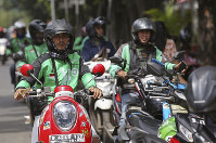Go-Jek drivers wait for customers in Jakarta, Indonesia, on May 24, 2018. (AP Photo/Achmad Ibrahim)