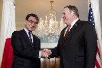 Secretary of State Mike Pompeo shakes hands with Japanese Foreign Minister Taro Kono at the State Department, on May 23, 2018, in Washington. (AP Photo/Andrew Harnik)