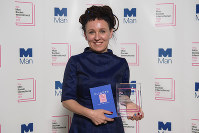 Polish author Olga Tokarczuk smiles after winning the Man Booker International prize 2018, on May 22, 2018, for her book Flights, at the Victoria and Albert Museum in London. (Matt Crossick//PA via AP)