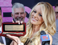 Stormy Daniels shows the Key during a ceremony for her receiving a City Proclamation and Key to the City on May 23, 2018 in West Hollywood, Calif. (AP Photo/Ringo H.W. Chiu)