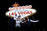In this Oct. 3, 2017 file photo, Elvis tribute artist Eddie Powers poses for a photo with newlyweds Rob and Kelly Roznowski after he married them at the Welcome to Las Vegas sign in Las Vegas. (AP Photo/Chris Carlson, File)