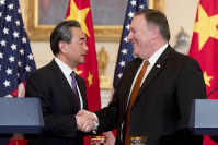 Secretary of State Mike Pompeo and Chinese State Councilor and Foreign Minister Wang Yi shake hands following a news conference at the State Department, on May 23, 2018, in Washington. (AP Photo/Andrew Harnik)