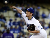 Los Angeles Dodgers starting pitcher Kenta Maeda, of Japan, throws against the Colorado Rockies during the first inning of a baseball game in Los Angeles, on May 23, 2018. (AP Photo/Chris Carlson)