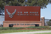 This photo shows the entrance to F.E. Warren Air Force Base in Cheyenne, Wyo. Documents obtained by The Associated Press reveal at least six airmen involved in a drug ring at F.E. (AP Photo/Mead Gruver)