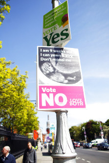 In this May 17, 2018 photo, pro and against posters are displayed on a lamppost in Dublin, Ireland ahead of the abortion referendum on Friday, May 25. (AP Photo/Peter Morrison)