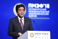 Japanese Prime Minister Shinzo Abe speaks at the St. Petersburg International Economic Forum in St. Petersburg, Russia, Friday, May 25, 2018. (Valery Sharifulin/TASS News Agency Pool Photo via AP)