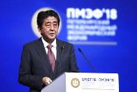 Japanese Prime Minister Shinzo Abe speaks at the St. Petersburg International Economic Forum in St. Petersburg, Russia, Friday, May 25, 2018. (Valery Sharifulin/TASS News Agency Pool Photo via AP)
