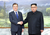 In this photo provided by South Korea Presidential Blue House via Yonhap News Agency, North Korean leader Kim Jong Un, right, and South Korean President Moon Jae-in, left, shake hands before their meeting at the northern side of the Panmunjom in North Korea, on May 26, 2018.  (South Korea Presidential Blue House/Yonhap via AP)