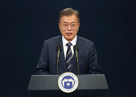 South Korean President Moon Jae-in speaks during a press conference at the presidential Blue House in Seoul, South Korea, Sunday, May 27, 2018. President Moon said North Korean leader Kim Jong Un remains committed to holding a summit with President Donald Trump and to the