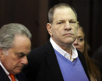 Harvey Weinstein, right, appears at his arraignment with his lawyer Benjamin Brafman, in Manhattan Criminal Court on Friday, May 25, 2018 in New York. Weinstein is charged with two counts of rape and one count of a criminal sexual act. He was released on $1 million bail. (Jefferson Siegel/New York Daily News via AP, Pool)
