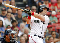 Boston Red Sox's Andrew Benintendi watches his two-run triple against the Atlanta Braves during the seventh inning of a baseball game at Fenway Park in Boston, Saturday, May 26, 2018. (AP Photo/Winslow Townson)