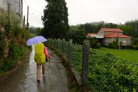 長い巡礼、ときには雨に降られる日もある。リュック用のレインカバーもほしい
