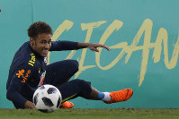 Brazil's Neymar smiles after taking a spill on the pitch during a national soccer team practice session ahead the World Cup in Russia, at the Granja Comary training center In Teresopolis, Brazil, Friday, May 25, 2018. (AP Photo/Leo Correa)