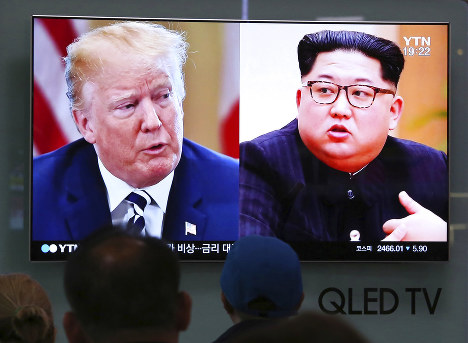 In this May 24, 2018, file photo, People watch a TV screen showing file footage of U.S. President Donald Trump, left, and North Korean leader Kim Jong Un during a news program at the Seoul Railway Station in Seoul, South Korea. (AP Photo/Ahn Young-joon, File)