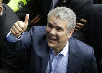 Ivan Duque, presidential candidate for the Democratic Center, gives a thumbs after voting during the presidential election in Bogota, Colombia, on May 27, 2018. (AP Photo/Fernando Vergara)
